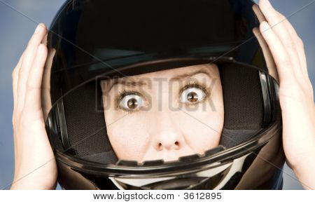 Woman With A Motrcycle Helmet And Surprised Expression