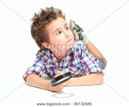 Pensive Little Boy With Weird Hair And Magnifier