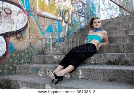 Futufistic Fasion Model Lying On Steps
