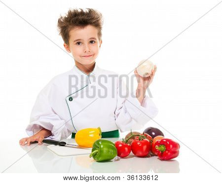 Little Boy Chef In Uniform With Knife Cooking Vegatables Holding Onion