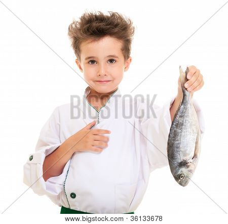 Little Boy Chef In Uniform Presenting Dorado Fish