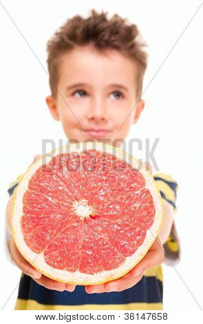 Little Boy Holding Grapefruit