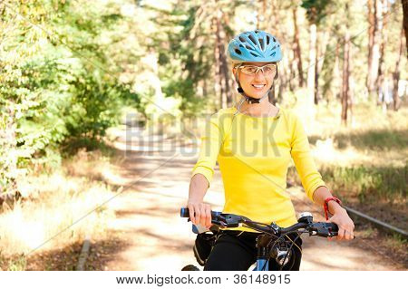 Woman  On The Bike In The Sunny Forest