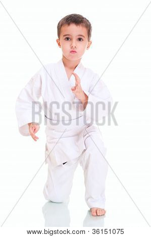 Aikido Boy Fighting Position In White Kimono
