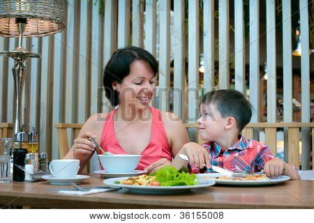 Mother and son having lunch together at the mall