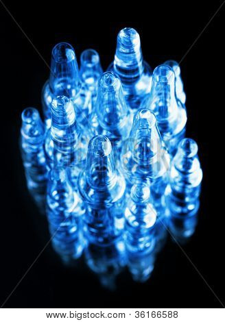 Medical Ampoules On Black Background