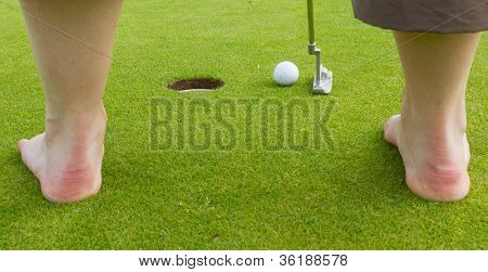 Golf Player Hitting The Ball