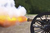 picture of artillery  - A close up shot of a Civil War cannon firing at a civil war re - JPG