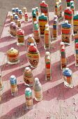 foto of saharan  - Colorful Saharan sand in glass bottles as souvenirs in the desert - JPG