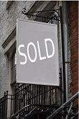 picture of brownstone  - this is my photo of a brownstone building with a sold sign - JPG