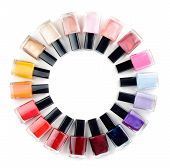 picture of painted toes  - Coloured nail polish bottles stacked circle on a white background - JPG