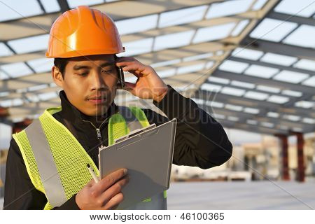 Engineer Construction Talking Mobile Phone Under New Building