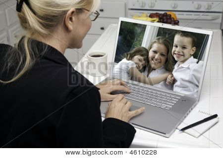 Woman In Kitchen Using Laptop - Family And Friends
