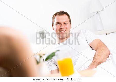 woman brought her boyfriend breakfast in bed