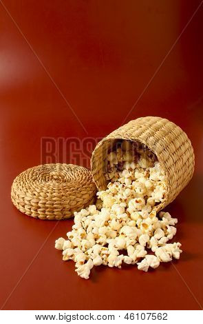 Popcorn In Bowl Isolated Red Background