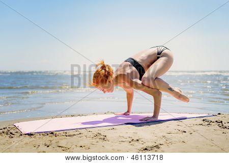 Woman doing bakasana
