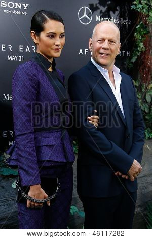 "NEW YORK - MAY 29: Actor Bruce Willis and wife Emma Heming attend the premiere of ""After Earth"" at the Ziegfeld Theatre on May 29, 2013 in New York City."