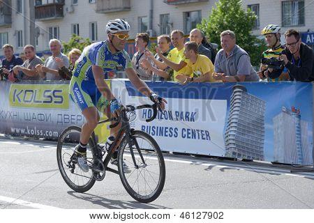 KIEV, UKRAINE - MAY 24: Mykhaylo Kononenko, Kolss cycling team, Ukraine, win bronze in the bicycle racing Race Horizon Park in Kiev, Ukraine on May 24, 2013