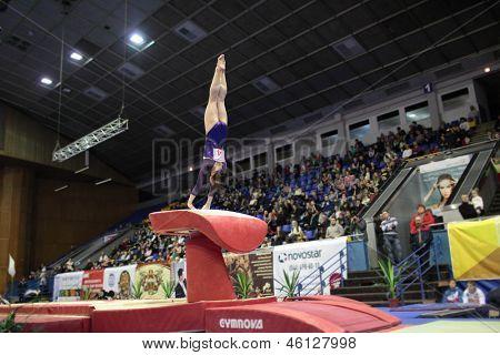 KIEV, UKRAINE - MARCH 30: Anna Dementieva, Russia performs vault during International Tournament in Artistic Gymnastics Stella Zakharova Cup in Kiev, Ukraine on March 30, 2013