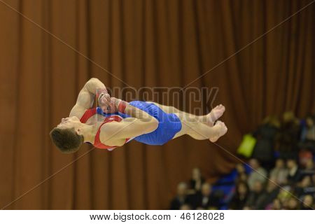 KIEV, UKRAINE - MARCH 31: Glenn Smink, Netherlands performs floor exercise during International Tournament in Artistic Gymnastics Stella Zakharova Cup in Kiev, Ukraine on March 31, 2013