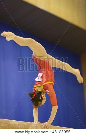 KIEV, UKRAINE - MARCH 31: Noda Sakura, Japan performs exercise on balance beam during International Tournament in Artistic Gymnastics Stella Zakharova Cup in Kiev, Ukraine on March 31, 2013