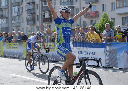 KIEV, UKRAINE - MAY 24: Denis Kostyuk, Kolss cycling team, Ukraine, win the bicycle racing Race Horizon Park in Kiev, Ukraine on May 24, 2013. The second is Alexander Sheydyk, ISD, Ukraine