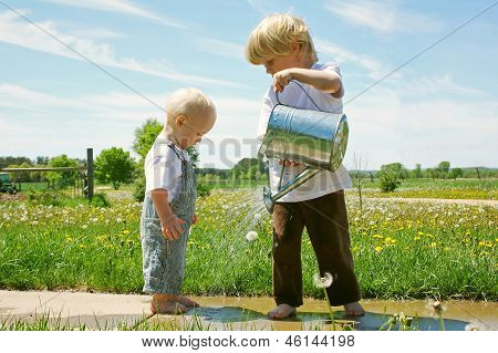 Brother Watering Baby