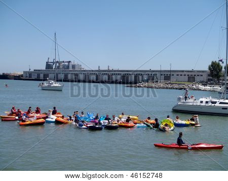 Boats, Kayaks, And People In Floatation Devices Wait In Mccovey Cove Hoping For A Homerun Ball