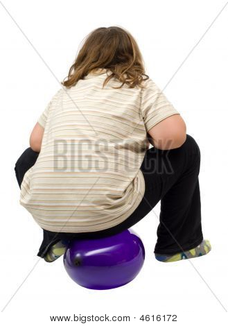 Child Sitting On Balloon