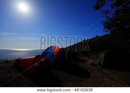 Tourist Tent At The Seaside. Moon Night. Mountain Meganom, Crimea, Ukraine