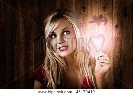 Attractive Young Blond Girl Holding Love Light