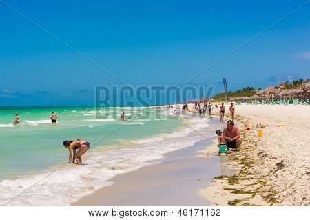 VARADERO,CUBA-MAY 19:Happy family enjoying the beach May 19,2013 in Varadero.With the growing flow of foreign visitors,tourism in Cuba grew 4.5% in 2012 with Varadero being its main destination