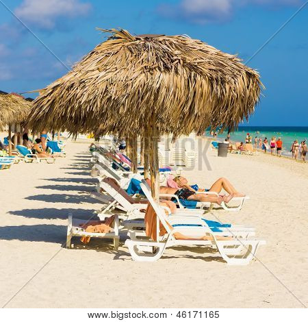 VARADERO,CUBA-MAY 19:Vacationers sunbathing at the beach May 19,2013 in Varadero.With the growing flow of foreign visitors,tourism in Cuba grew 4.5% in 2012 with Varadero being its main destination
