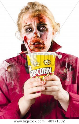 Zombie Woman Watching Scary Movie With Popcorn