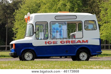 Side view of ice cream van in green countryside