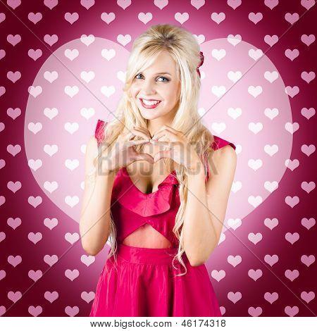 Beautiful Blonde Woman Gesturing Heart Shape