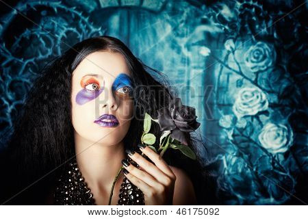 Gothic Girl Holding Black Rose. Death And Mourning