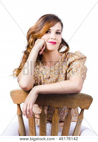 Stylish Girl At Rest On Antique Chair