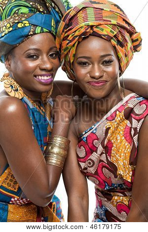 Two young beautiful african fashion modesl on white background.