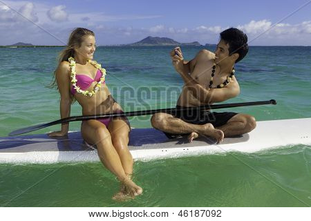 two On Paddle Board Photographing