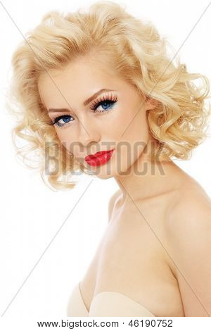 Young beautiful sexy blonde with stylish make-up and hairdo over white background