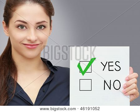Business Woman Holding Blank And Voting For Yes In Option