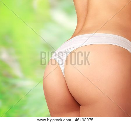 Woman Perfect Body In Lingerie On Green Nature Background