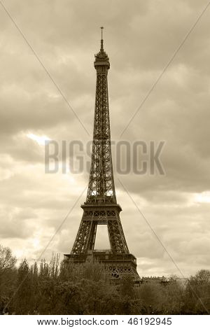 retro style photo of Eiffel Tower (nickname La dame de fer, the iron lady),The tower has become the most prominent symbol of both Paris and France