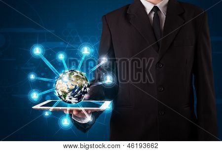 Young businessman presenting 3d earth globe in tablet - elements of this image furnished by NASA