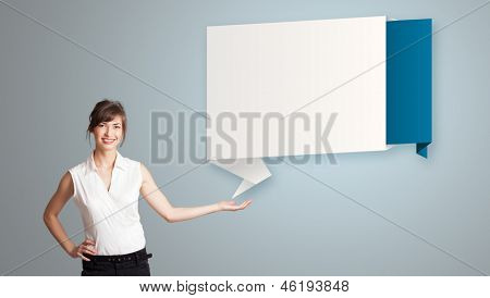attractive young woman presenting modern origami copy space