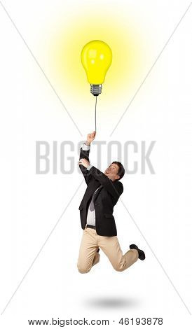 Happy young man woman holding a light bulb balloon