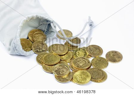 Close up of gold coins on the White background