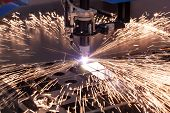 stock photo of ignite  - Industrial machine for cutting metal plasma - JPG