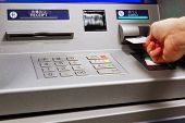 picture of automatic teller machine  - insert card in a ATM machine - JPG